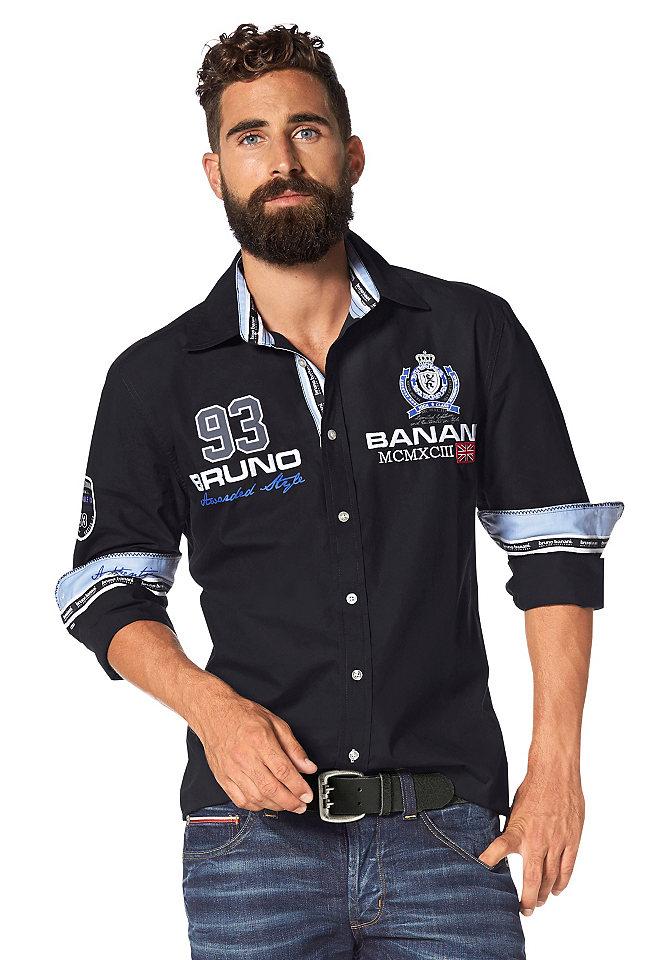 Рубашка OttoУличная одежда<br>Стильная молодежная рубашка от Bruno Banani - новый тренд для мужского гардероба! Декор в виде вышивки, принтов и нашивок, дополненный контрастной расцветкой внутренней стороны планки с пуговицами, воротника и манжет, придает модели выразительный вид, а чистый хлопок обеспечивает оптимальный комфорт.<br><br>Size DE: M<br>Colour: черный<br>Gender: Мужской<br>Age: Взрослый<br>Material: Верх: 100% хлопок