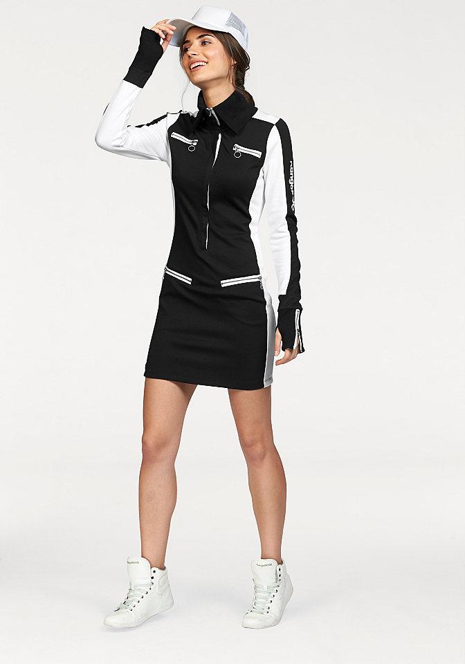 Платье, Kangaroos OttoПлатья из джерси<br>От KangaROOS, в стиле 3-цветной футболки с воротником «гольф» и роскошной отделкой застёжками на молнию. С отверстиями для большого пальца. Длина ок. 86 см. 76 % полиэстера, 20 % вискозы, 4 % эластана.<br><br>Size DE: 44<br>Colour: черный<br>Gender: Женский<br>Age: Взрослый<br>Material: Верх: 75% полиэстер / 20% вискоза / 5% эластан