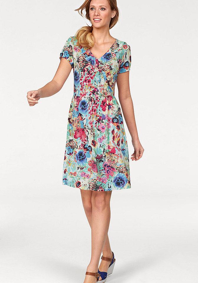 Платье OttoПлатья из джерси<br>Женственное платье в цветочек - летний хит от марки Cheer! Треугольная горловина украшена пышной оборкой и имитацией запаха. Фасон платья с короткими рукавами формирует идеальный силуэт, делая акцент на талии. Мягкое тянущееся джерси из стрейчевой вискозы подарит вам приятную прохладу. Длина составляет примерно 94 см.<br><br>Size DE: 38<br>Colour: бежевый<br>Gender: Женский<br>Age: Взрослый<br>Material: Верх: 95% вискоза / 5% эластан