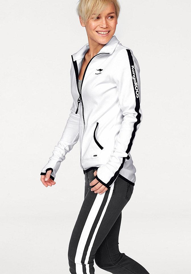 Толстовка OttoСпортивные куртки<br>Спортивная толстовка от марки KangaROOS - это сочетание стиля и комфорта! Окантовка и принты контрастного цвета придают ей выразительный вид и подчеркивают ее динамичность. Воротник-стойка, практичная молния и карманы кенгуру демонстрируют спортивный характер модели. Благодаря натуральному хлопку кофточка очень приятна для тела, и носить ее вам будет очень удобно. Хлопковая толстовка - достойный выбор для кэжуал-гардероба! Детали: удлиненная спинка, прорези для большого пальца на рукавах. Длина составляет 72 см.<br><br>Size DE: 32<br>Colour: белый<br>Gender: Женский<br>Age: Взрослый<br>Material: Верх: 100% хлопок