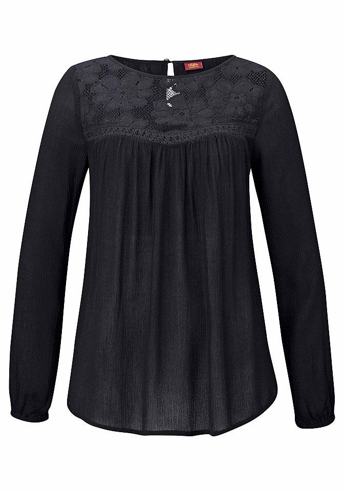 Блузка OttoФутболки<br>Маст-хэв для гардероба отпускницы - блузка из 100% вискозы от марки Buffalo London. Вставка из ажура на груди служит привлекательным элементом. Сборки на груди и немного расклешенный фасон хорошо обыгрывают фигуру. Длинным рукавам придается стильный объем с помощью канта-резинки. Ткань с хлопковой вставкой приятно струится и заботится о комфорте. Длина составляет примерно 62 см.<br><br>Size DE: 42<br>Colour: черный<br>Gender: Женский<br>Age: Взрослый<br>Material: Вставка: 100% хлопок;Верх: 100% вискоза